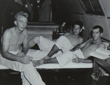 (L to R) Glen L. Milbrodt, S2c USNR; Lewis P. Bitonti, S1c USNR; and Pfc. Giles G. McCoy USMC, survivors of the USS Indianapolis in Naval Base Hospital No. 20, Peleliu, 5 August 1945.