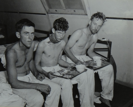 (L to R) Bernard B. Bateman, F2c USNR; A.C. King, S1c USNR; and Erick T. Anderson, S2c USNR, survivors of the USS Indianapolis in Naval Base Hospital No. 20, Peleliu, 5 August 1945.