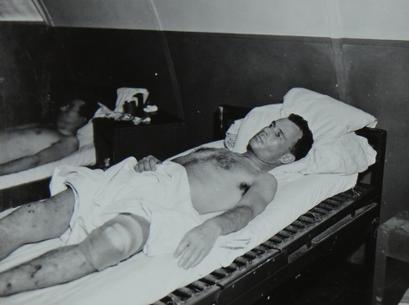 Lt. Comdr. John Reid USNR,  survivor of the USS Indianapolis in Naval Base Hospital No. 20, Peleliu, 5 August 1945.