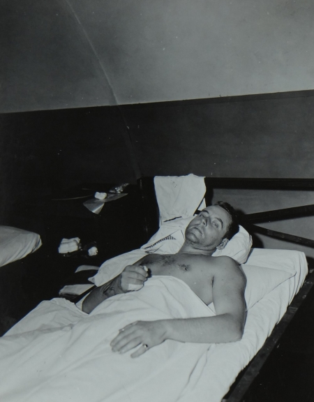 Lt. Comdr. Lewis L. Haynes MC, USN, survivor of the USS Indianapolis in Naval Base Hospital No. 20, Peleliu, 5 August 1945.