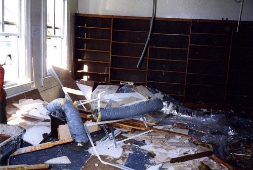 Aftermath of the chimney falling through the roof of the reference room (Bldg. 44) of Navy Department Library, January 1996.