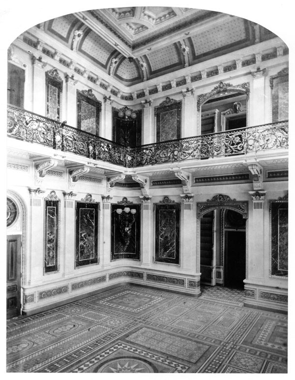 View of the interior of the library of the Navy Department, east wing as photographed ca. 1879, shortly after the room's completion. Not the wall panels of various types of marble and the tile floor. Collection: Library of Congress, Prints & Photographs. Negative: LC-number pending
