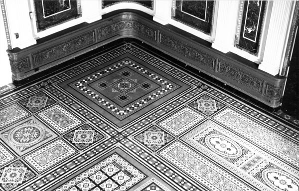 Detail of the title floor of the former library of the Navy Department, east wing. Photograph taken by Richard Cheek, summer 1976, for the Dunlap Society.