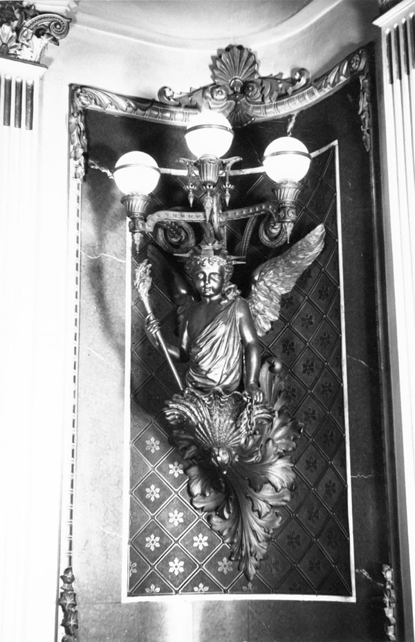 Detail of corner lighting fixture in the former library of Navy Department, showing a figure representing Liberty. Photograph taken by Richard Cheek, summer 1976, for the Dunlap Society.