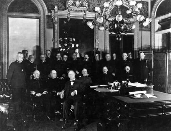 View of the office of Secretary of the Navy, east wing, showing Secretary Josephus Daniels with officers. Photograph by the Navy Department, taken between 1913-1918. Collection: National Archives and Records Administration. Audiovisual; photo no. 19-N-5-62.