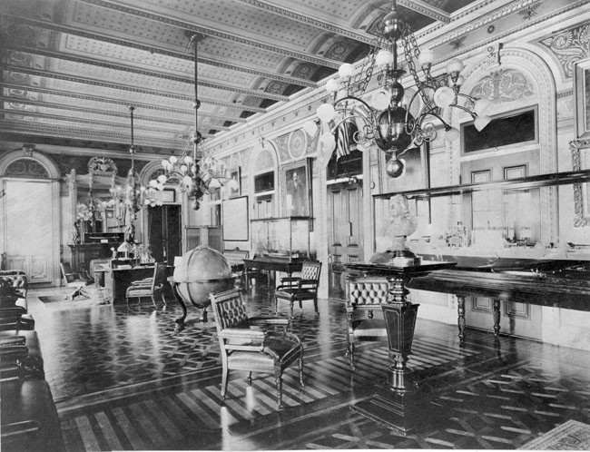 Figure 33: The former office of the Secretary of the Navy, photographed ca. 1912. Like other offices in the building designed for the department secretaries and high-level assistants, this room was decorated with a substantial amount of stencilling and gold leaf Now serving as the Vice President's office, it still retains its original black marble mantels and inlaid marquetry floor. Reproduced courtesy of US Naval Institute.