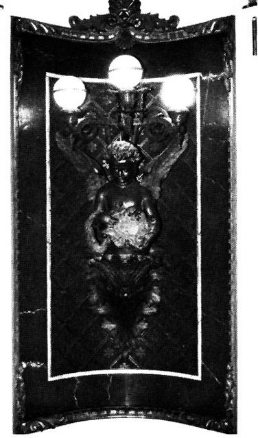 Figure 40: Arts and Sciences Lamp, Indian Treaty Room. This figure carries a wreath and cartouche decorated with maps of the two hemispheres.