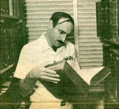 YNC Paul J. Heine, Assistant Administrative Personnel Officer for the Navy Department Band researches in an old volume of Lloyd's Register.
