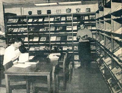 One of many scholars researches an article for the Naval Institute in the Navy Department Library's periodicals section.