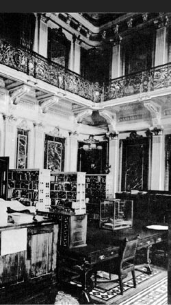Navy Department Library was located in the State, War, and Navy Building, 17th and Pennsylvania Avenue NW. This room was called the Indian Treaty Room, photographed circa 1915.
