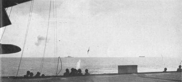Image from deck showing suicide plane in background.