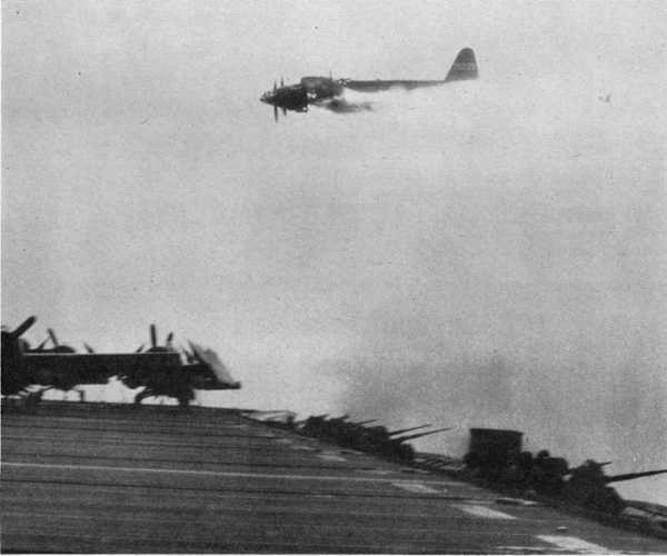 Attacking Japanese aircraft on fire.