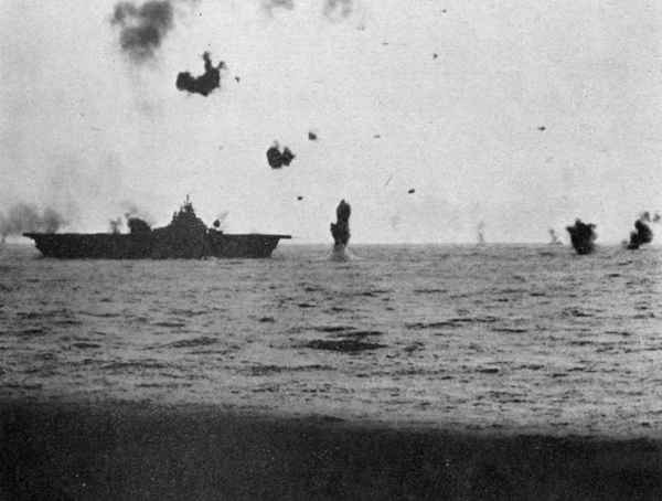 Antiaircraft action off carrier.
