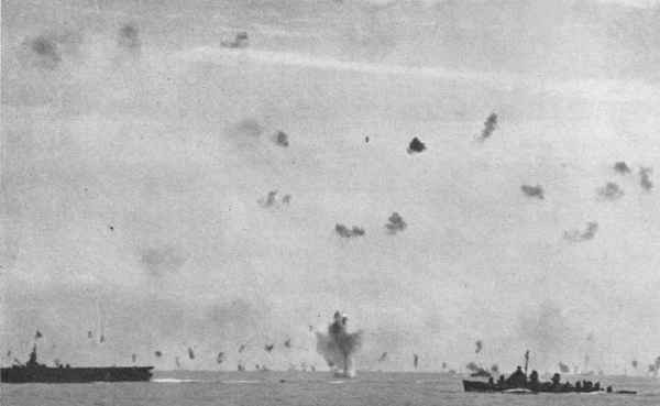Antiaircraft action over the fleet.