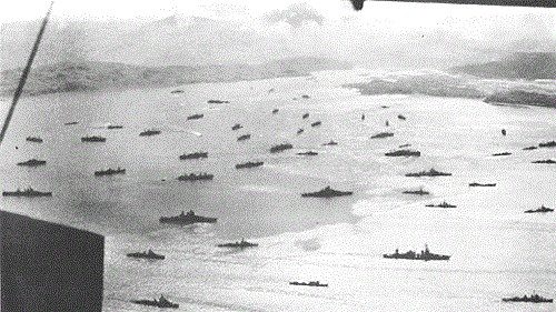 Invasion fleet gathers in Adak Harbor for assault on Kiska.
