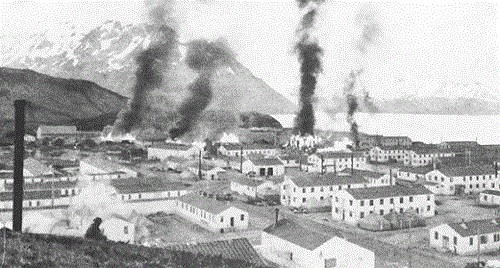 Burning buildings at Ft. Mears after first enemy attack on Dutch Harbor, 3 June