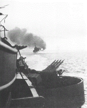 The St. Louis fires a salvo at Kiska during the bombardment of 7 August 1942