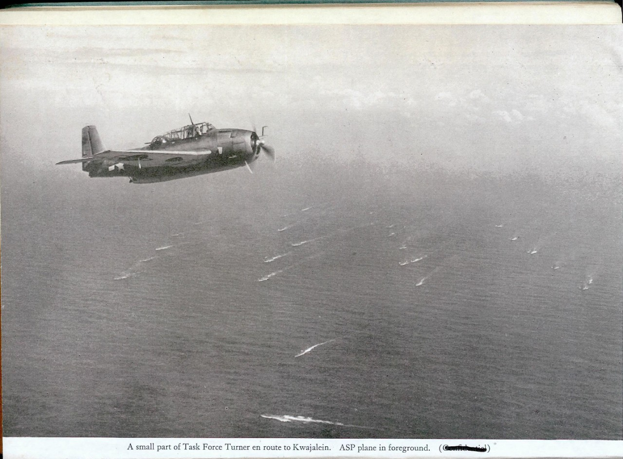 A small part of Task Force Turner en route to Kwajalein. ASP plane in foreground