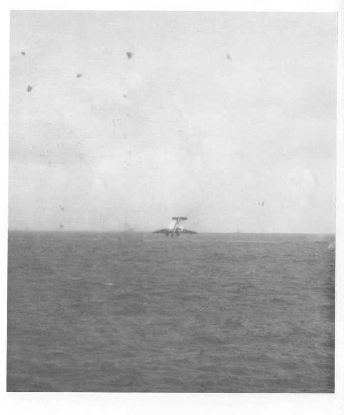 "Japanese ""Irving"" (shown in preceding picture) hit and burning; plunges seaward after receiving additional hits."