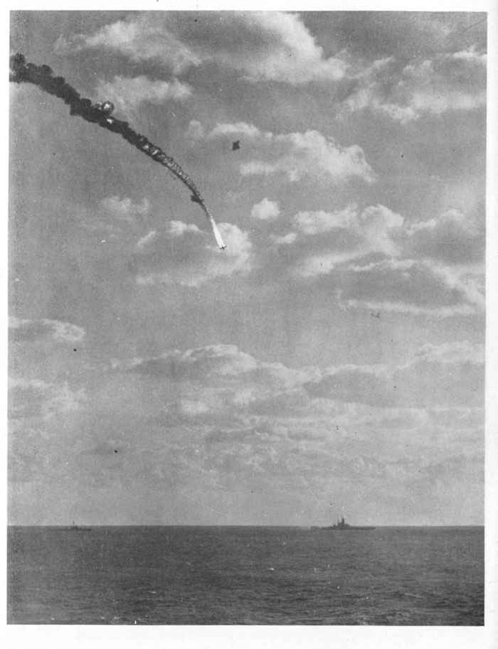 Japanese plane bursts into flames and misses target by wide margin.