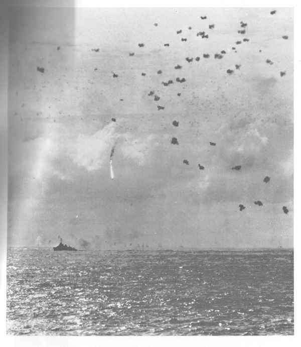 Enemy plane shot down by ship's AA within formation.