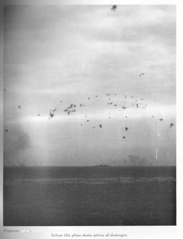 "Japanese plane approached through clouds above destroyer. High volume of accurate 5"" fire brings this plane down astern of destroyer."