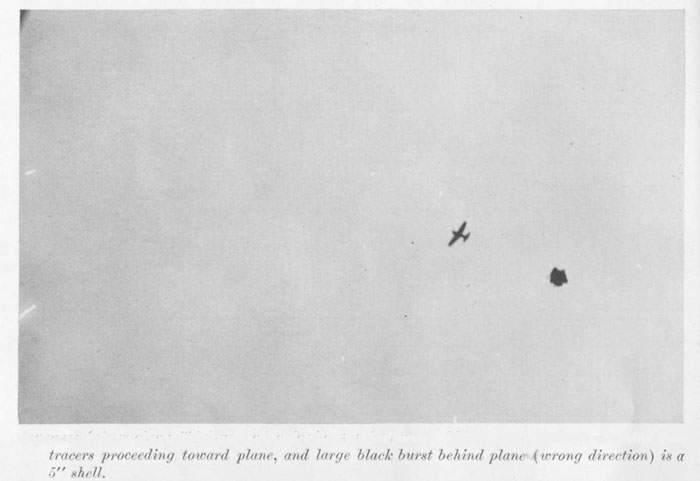"Japanese fighter plane (""Zeke"") under pre by AA batteries. White spots indicate machine gun tracers proceeding toward plane, and large black burst behind plane (wrong direction) is a 5"" shell."