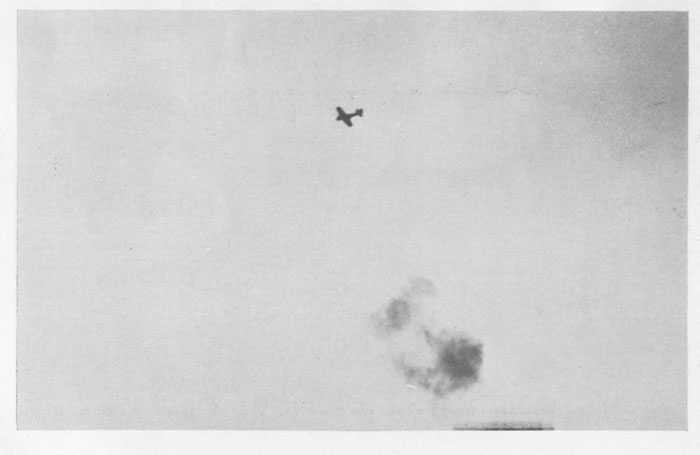 "Japanese fighter plane (""Zeke"") under 5"" and machine-gun fire."