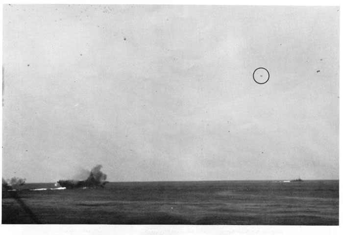 Japanese plane making approach on carrier. Plane has just passed over destroyer on right.