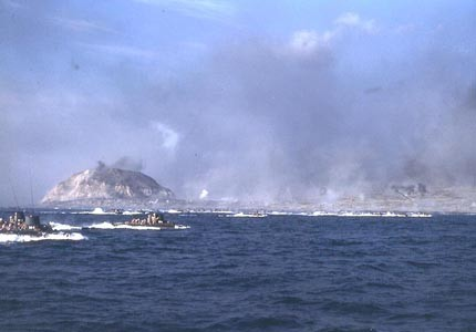 Amphibious tractors approaching Iwo Jima, February 1945. NHHC, Photographic Section #NH 104317-KN.