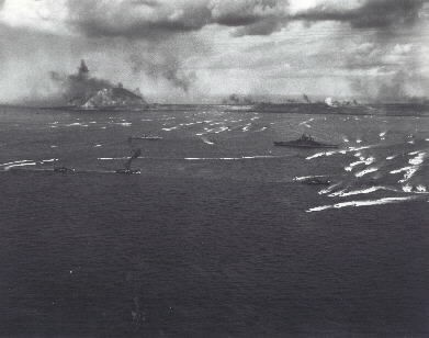 Iwo Jima Invasion, Feb. 1945: LVTs retracting from the Iwo Jima beaches  after landing the initial waves of marines, in the morning of 19 February, 1945. USS Tennessee (BB-43) is in the right center. Photograph attributed to LtJG Gene Senier. NHHC Photographic Section #80-G-474795.