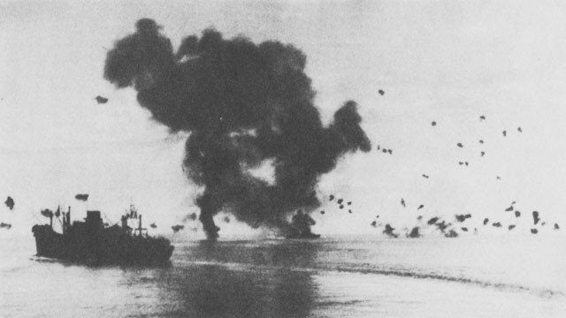Air Attack of 12 November. Burning torpedo plane (left center) has crashed into the San Francisco (right center). Left foreground, President Jackson.