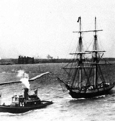 USS Niagara (1813-1820) Replica, under tow of the tug Buffalo, during the Perry Centennial Naval Parade, 1913. Possibly at Erie, Pa.