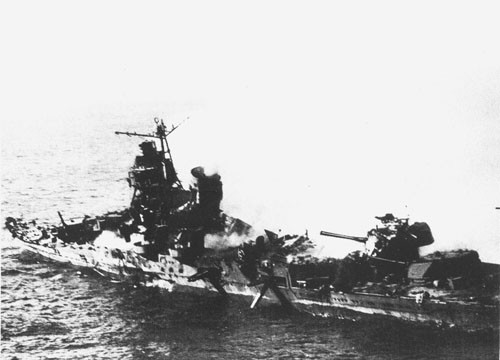"Japanese Mogami class cruiser left ""gutted and abandoned"" after attack by our carrier-based planes on June 6th."