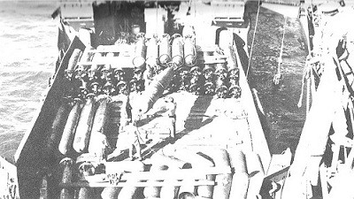 Image of Torpedoes being hoisted aboard Lexington.