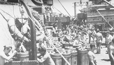 Image of ammunition ship Shasta loading 14-inch powder and shells onto the New Mexico.