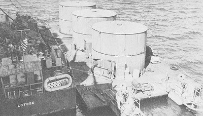 Image of a gasoline lighter and an LCT alongside the carrier Intrepid.