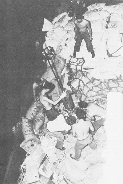 Image of men taking sugar on the carrier Lexington at night.