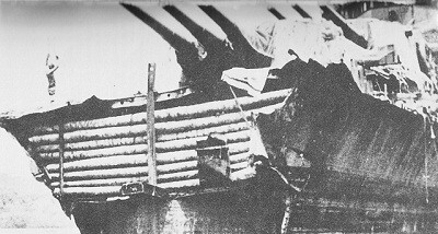 Image of Minneapolis, bow repaired with coconut palm tree trunks.