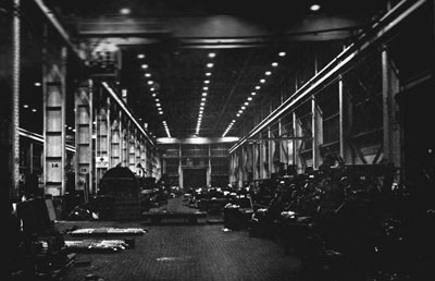 Machine Shop, Terminal Island, Interior view, taken at night.