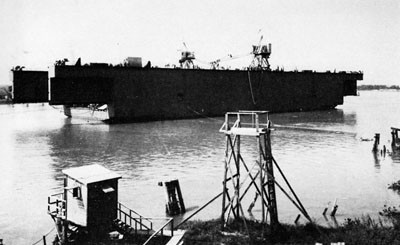 Launching the Center Section of YFD-6. This 18,000-ton steel floating drydock was launched at Morgan City, La., October 1943.
