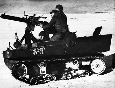 Seabees Manning an Anti-aircraft Machine Gun Mounted on Tractor.