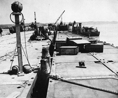 Pontoon Pier at Katchin-Hanto, Okinawa, May 1945.