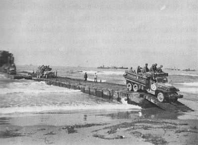 1006th Seabees in the Salerno Invasion Unloading an LST Over a Pontoon Causeway at Safta Beach.