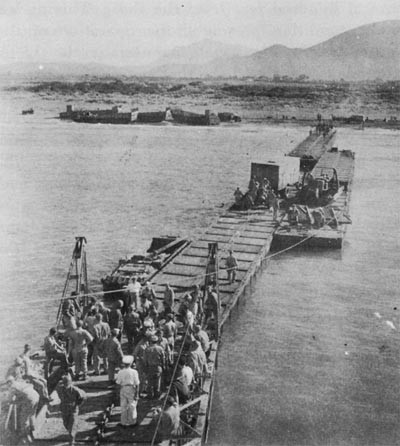1006th Seabees Using a Three-Section Pontoon Causeway at Safta Beach.