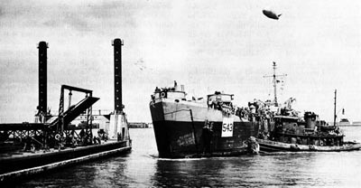 LST Moves in to Secure to a Leibnitz Pier, OMAHA Beach.