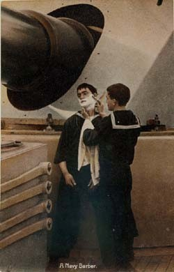 "Image of ""A Navy Barber"", gives a shave to a battleship crewman, during the early 1900s. NH 94301-KN."
