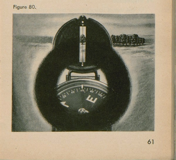 Figure 80: An up close view of looking through the front sight of a compass.