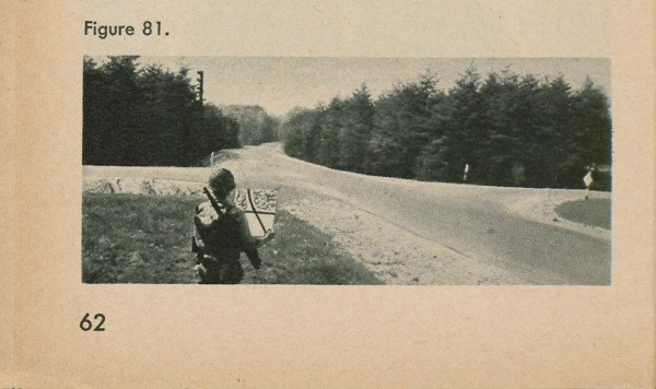 Figure 81: A man at an intersection holding a map.