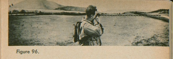 Figure 96: A soldier using a compass to get the azimuth.